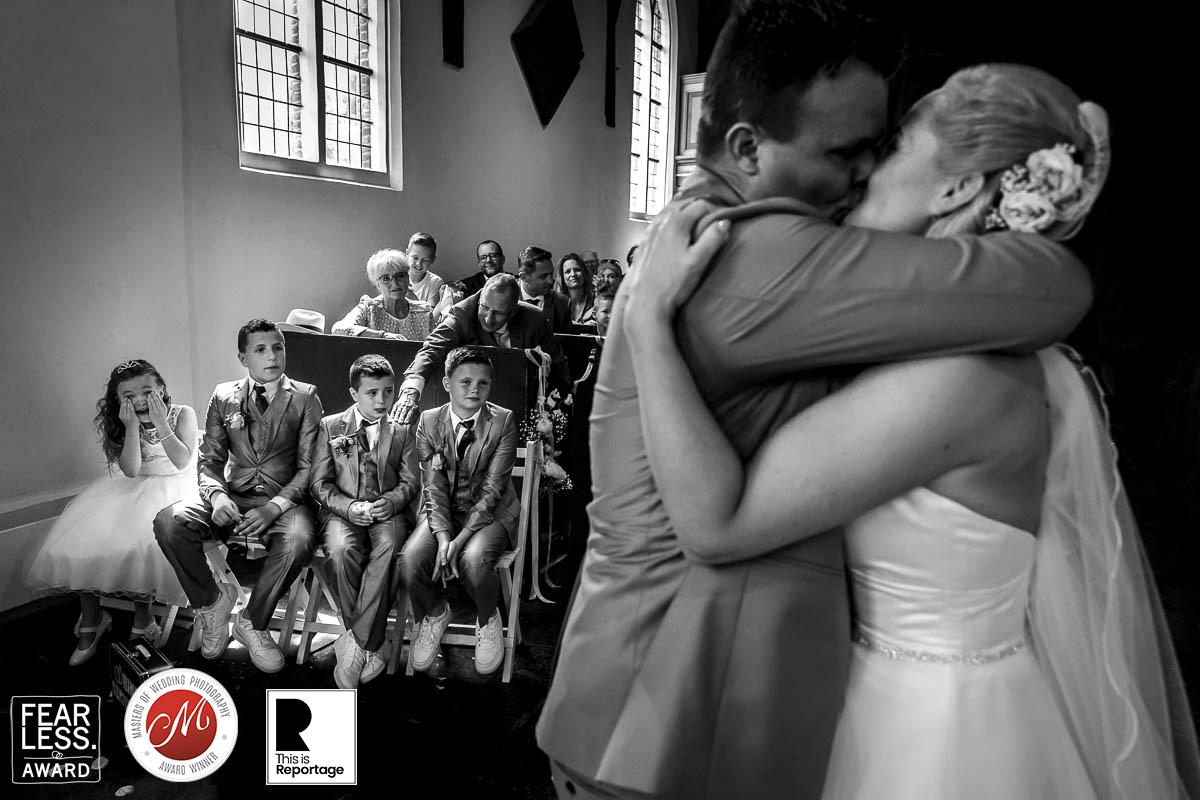 bruidsfotografie awardwinnende fotograaf bruiloft ceremonie de kus